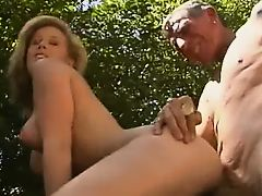 Blonde nurse takes good of old man