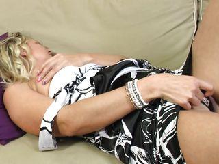mature blonde slut masturbates on the couch