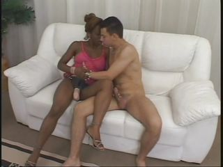 sexy ebony slut with a strap on sucks her man's white cock