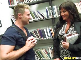 hot milf gets naked in the library