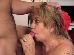 Big old grandma massages her boy toy