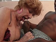 Wrinkly old hag takes black cock outdoors