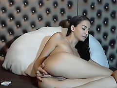 Smiling female seriously approaches pussy masturbation