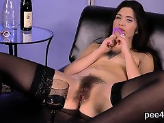 Gorgeous nympho is pissing and pleasuring shaven pussy