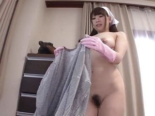 naked japanese milf cleans the living room