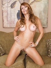 A brunette MILF with big tits showing off her body