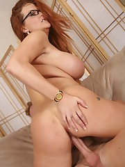 Buxom and horny redhead riding her stepsons cock like a pro