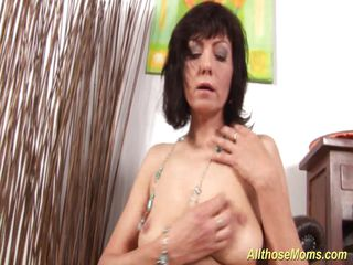 horny mom rubbing her wet pussy