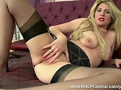 Blonde slut Ashleigh McKenzie teasing and playing with her pussy in the bedroom in retro lingerie nylons and heels this horny MILF is all juiced up