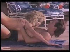 Blonde Ginger Lynn gets fucked by the pool in a vintage porno