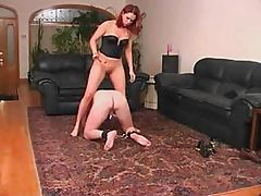 Mistress is making her slave do what she wants and humiliates him