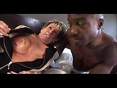 Granny gets a black stud in her bed and fucks his black cock