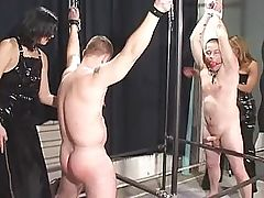 two women bind and tease two men