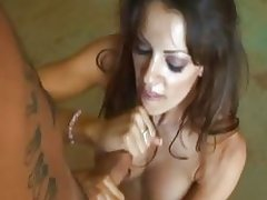 Brunette gives a hand job in the living