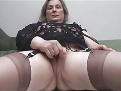 Granny in Stockings Removes Panties for Fingering