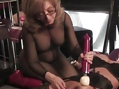 Nina Hartley loves tormenting Deuxma's moist pussy