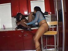 Jada Fire and Sydnee Capri fuck each other's pussies with dildos in the kitchen