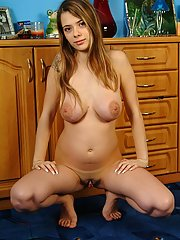 A pregnant teen poses naked in her mothers bedroom