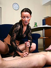 Eager slave licks his mistress's toes while getting a nice handjob from her raunchy blonde kitty friend
