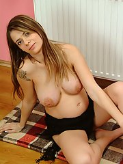 Nina shows off her big pregnant boobies